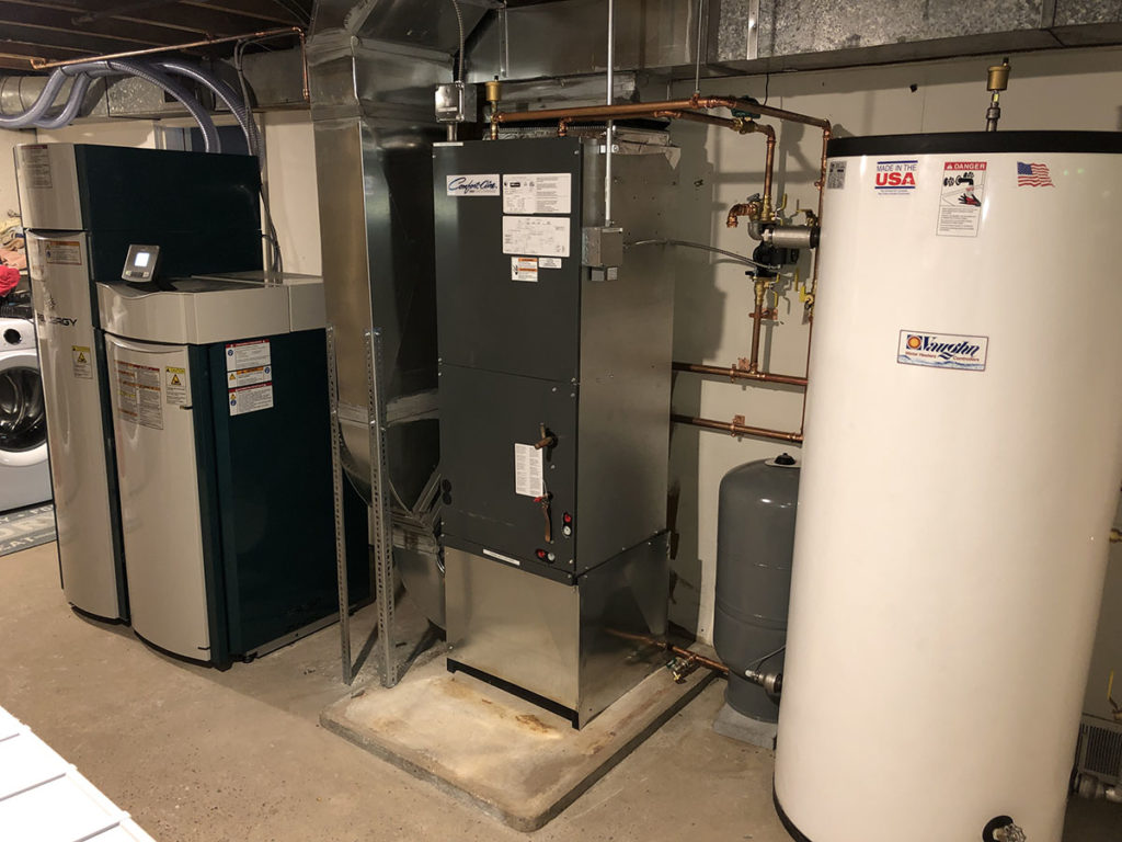 This boiler sends hot water to a hydro /air coil which works just like a wood pellet furnace.